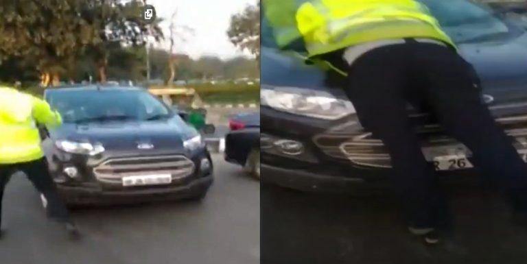 गाड़ी के बोनट पर सवार पुलिसकर्मी; गलत तरफ चल रहा था ड्राईवर!