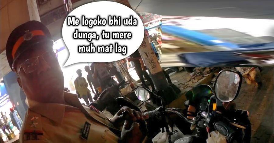 देखिये कैसे बिना हेल्मेट लगाए पुलिसकर्मी ने सिग्नल तोड़ा और फिर बाइकर को गाली दी!