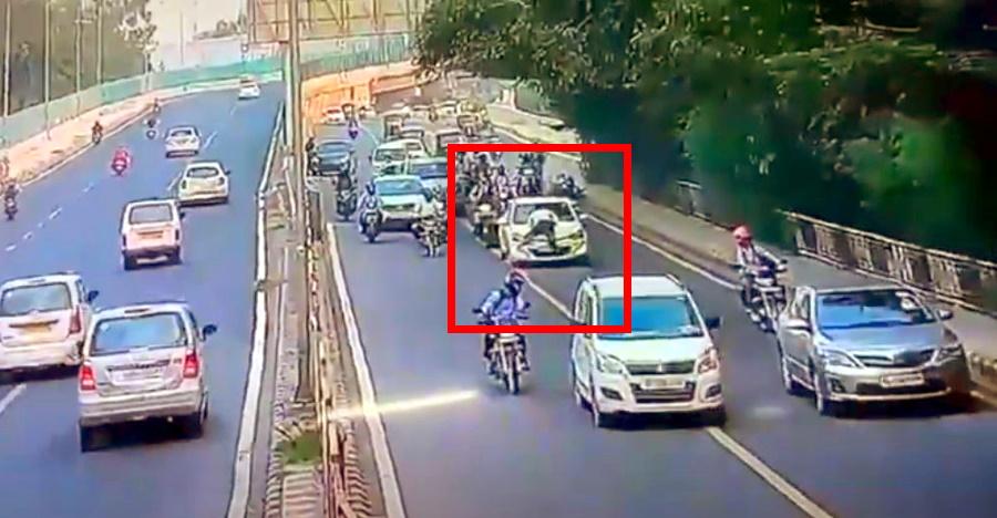 आदमी कार के बोनट पर पुलिस के साथ ड्राइव करता है: कैमरे पर पकड़ा गया