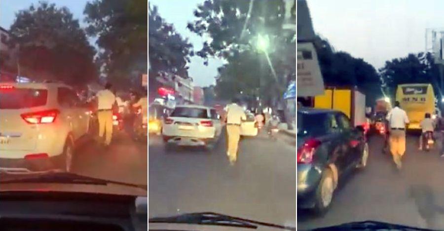 ट्रैफिक जाम में रास्ता बनाने के लिए भारतीय पुलिसकर्मी 2 किमी तक एम्बुलेंस से आगे चलते हैं [वीडियो]