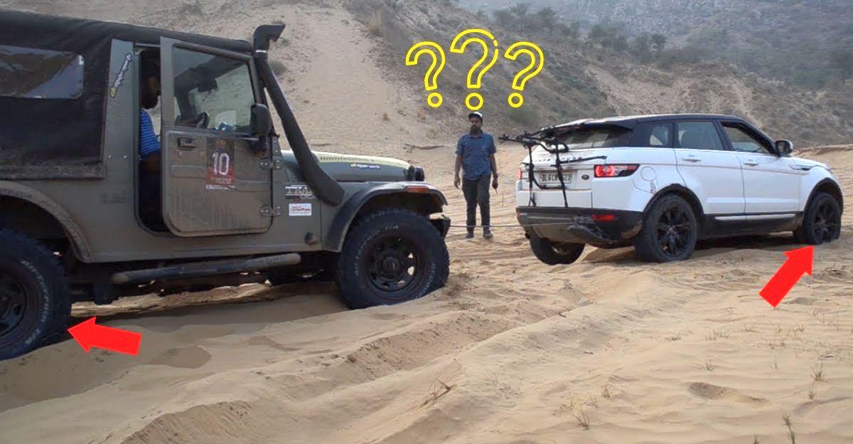 Mahindra Thar रेत में फंसी Range Rover Evoque को बचाती है