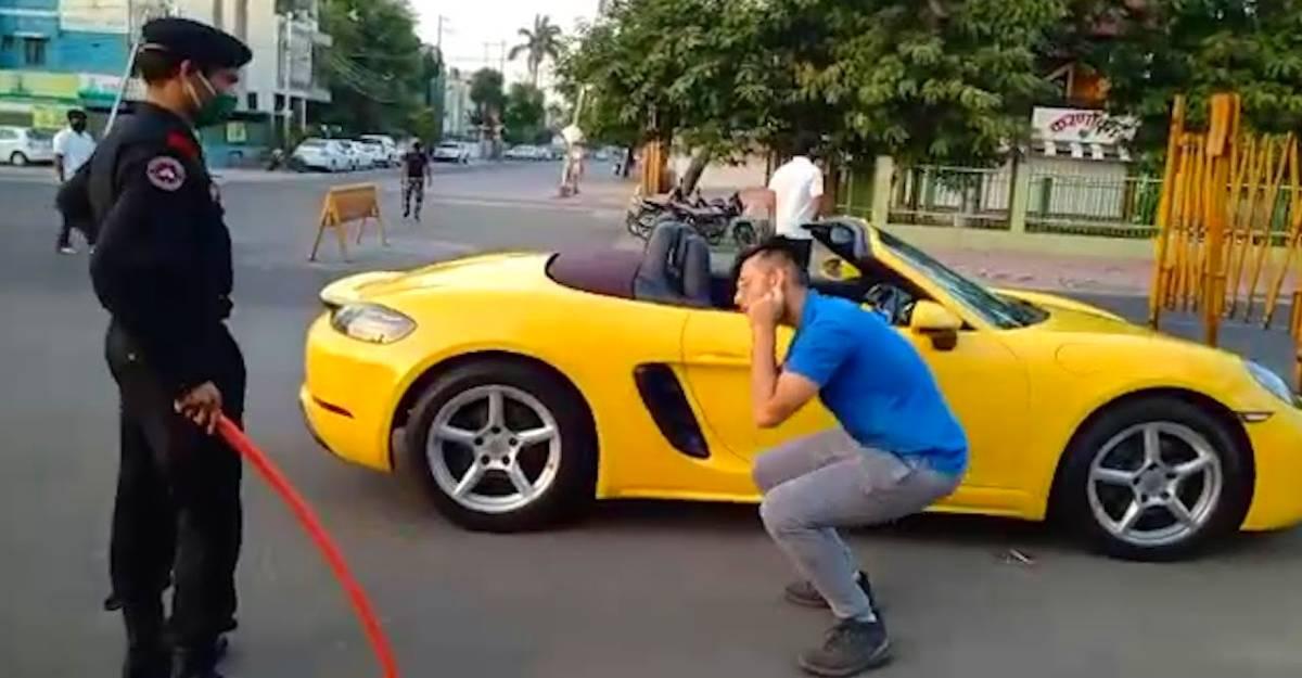 वह क्षण जब सड़क के बीचों बीच एक Porsche मालिक को उठक बैठक कराया गया