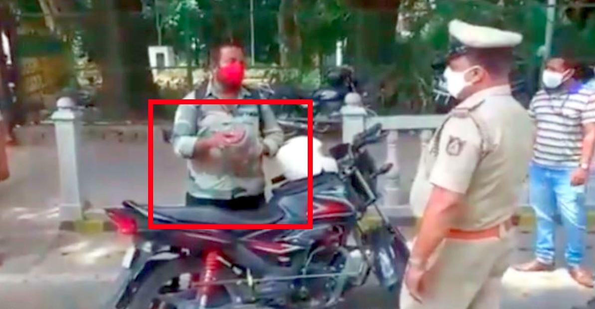 लॉकडाउन उल्लंघन पर पुलिस ने बाइकर को रोका: कोबरा सांप को कारण के रूप में बताया [वीडियो]